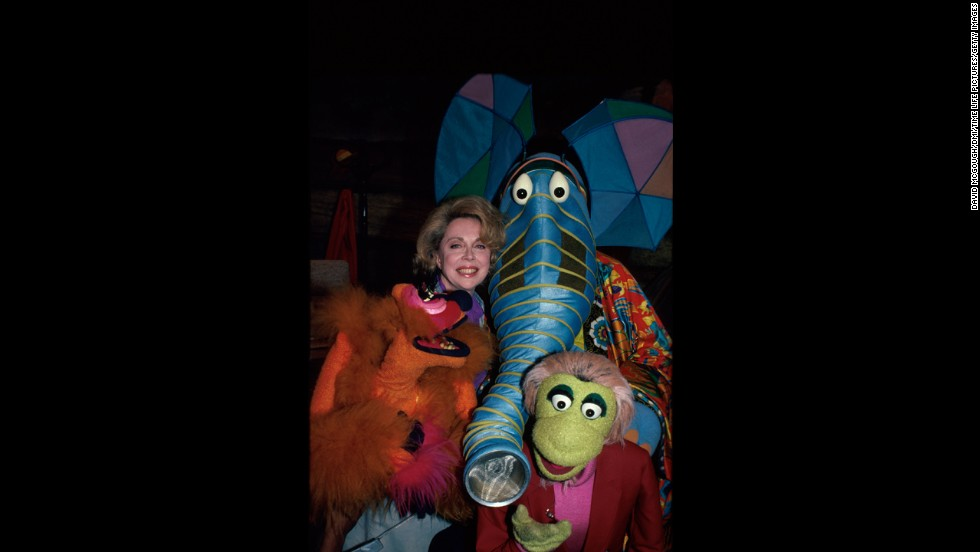 """Brothers poses with characters from """"The Great Space Coaster."""""""