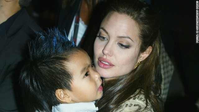 "VENICE, ITALY - SEPTEMBER 10:  Actress Angelina Jolie and her son Maddox attend the World Premiere of ""Shark Tale"" in San Marco Square, as part of the 61st Venice Film Festival on September 10, 2004 in Venice, Italy. (Photo by Pascal Le Segretain/Getty Images)"