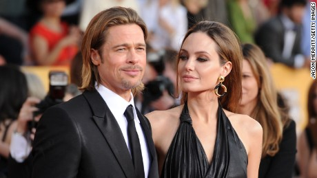 LOS ANGELES, CA - JANUARY 29:  (L-R) Actor Brad Pitt (L) and actress Angelina Jolie arrive at the 18th Annual Screen Actors Guild Awards at The Shrine Auditorium on January 29, 2012 in Los Angeles, California.  (Photo by Jason Merritt/Getty Images)