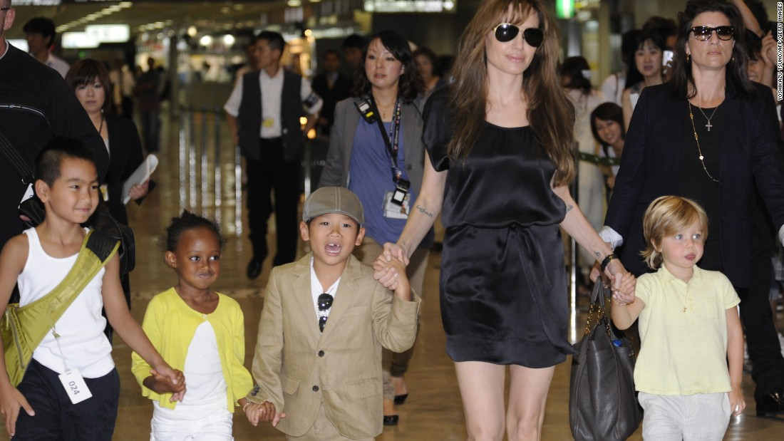 Jolie walks with four of her children -- from left, Maddox, Zahara, Pax and Shiloh -- at Japan's Narita International Airport in July 2010. Jolie and Pitt are the parents of six children. Jolie gave birth to twins Vivienne and Knox in July 2008.