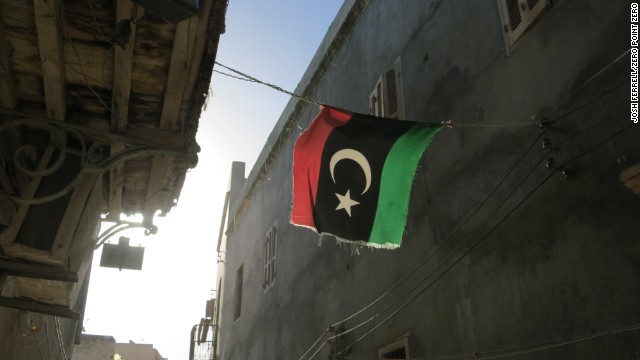 A Libyan flag hangs in an alleyway in Old Town, Tripoli.