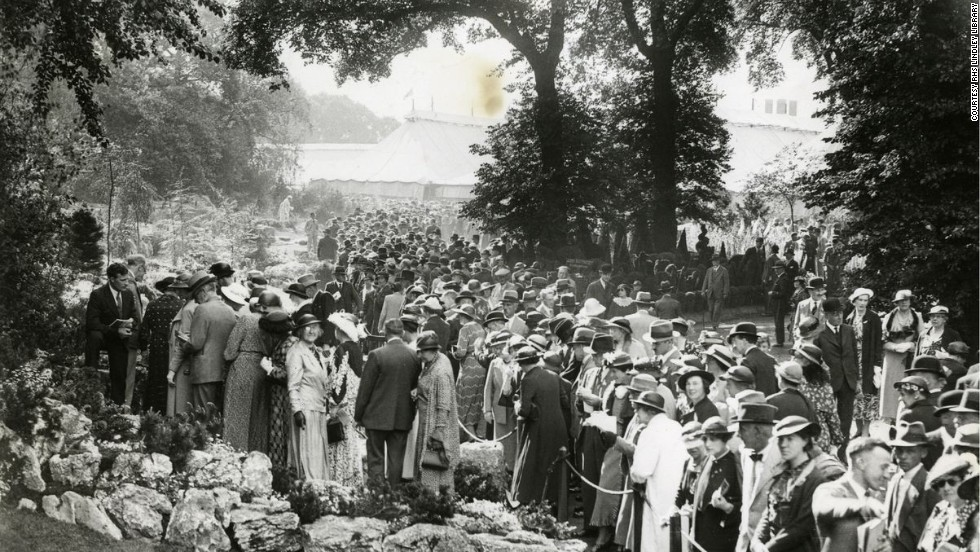 Chelsea Flower Show has always been popular with the crowds, as this 1936 photograph shows. In 1979 turnstiles were introduced to prevent overcrowding and a ceiling has since been put on the number of tickets sold.