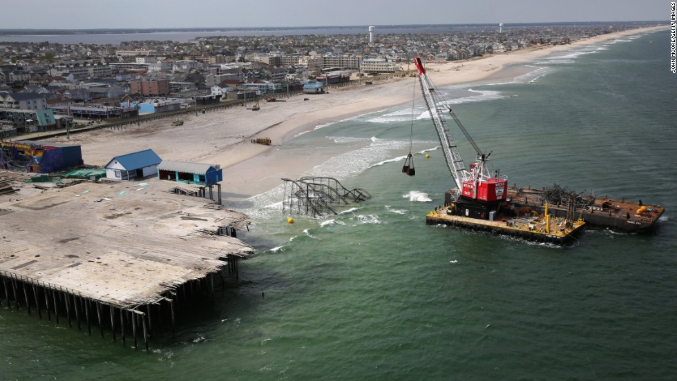 A crane demolishes the Jet Star roller coaster on Tuesday, May 14, 2013, in Seaside Heights, New Jersey, almost seven months after it fell into the ocean during Superstorm Sandy.