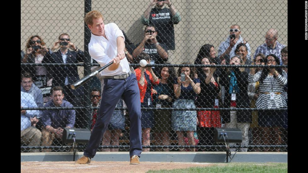 Prince Harry hits a baseball while participating in drills at the Harlem RBI baseball youth development program in New York, during the fifth day of his visit to the United States on Tuesday, May 14.