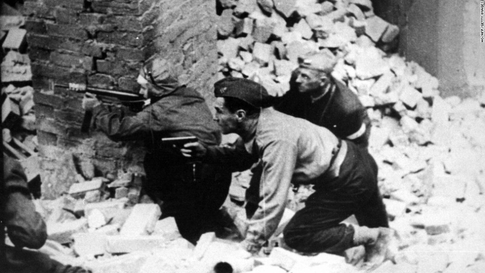 During April 1943 the first urban mass rebellion against the Nazi occupation of Europe started in the Warsaw ghetto. Pictured here are insurgents fighting in the streets of Warsaw during the uprising.