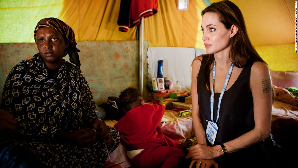 """According to <a href=""""http://www.unhcr.org/pages/49db77906.html"""" target=""""_blank"""">UNHCR</a>, she has donated $5 million to their causes since 2001. In addition to the numerous visits to refugee camps, like the Shousha camp in Tunisia (pictured), the humanitarian has also launched several organizations which provide aid in education and healthcare for refugees."""