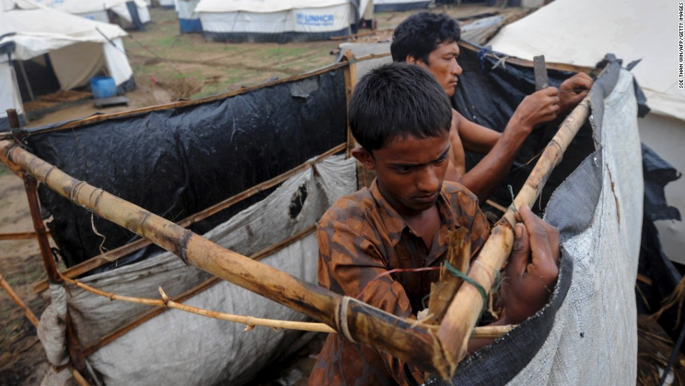 A man fixes his tent on May 15 at the Ohnedaw camp.
