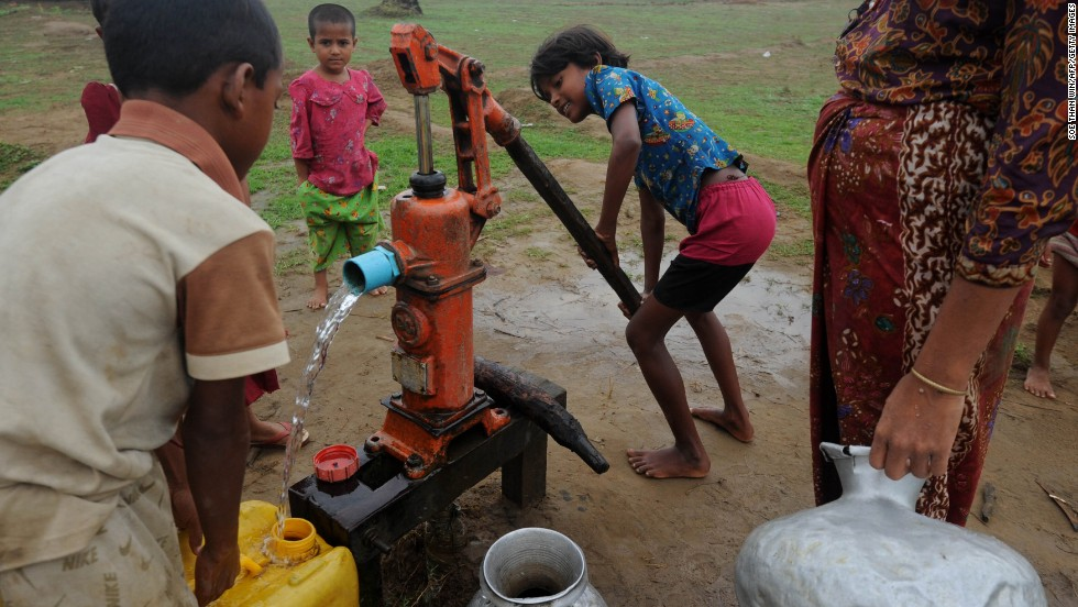 Children pump water at the Ohnedaw camp near Sittwe on May 15.