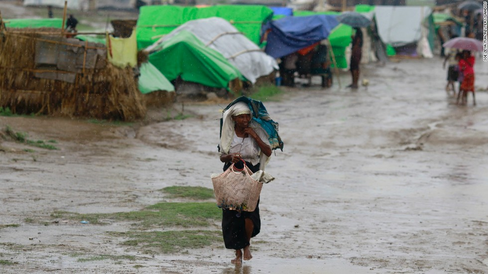 A woman from the Thandawli village walks through the rain in a Rohingya displacement camp outside Sittwe on May 14.