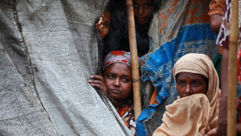 Muslim Rohingya women sit inside a tent at the Mansi displacement camp in Sittwe on May 14.