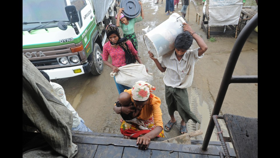 Rohingya family members board a truck with their belongings as they prepare to move from tents to a safer area on May 16.