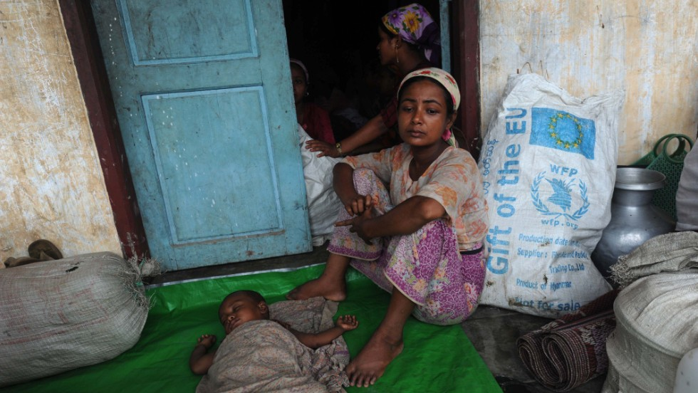 Members of a displaced Rohingya Muslim family rest at a camp outside Sittwe, Myanmar, on Thursday, May 16, as heavy rains and strong winds from Tropical Cyclone Mahasen lash coastal areas.