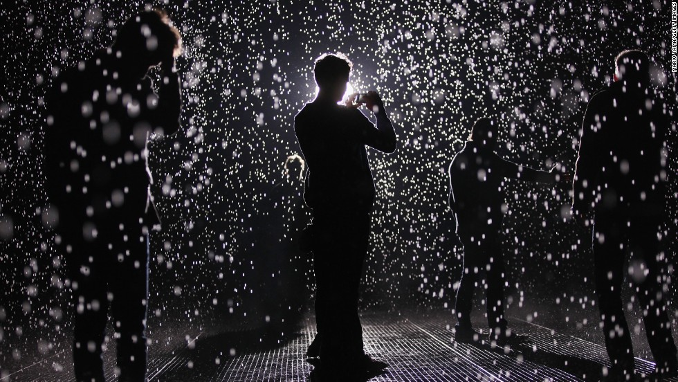 "MAY 15 - NEW YORK, U.S.: The new ""Rain Room"" installation at the Museum of Modern Art in New York City creates a field of falling water that stops in the area where people walk through, allowing them to remain dry. The piece releases a 260-gallon of water per minute."