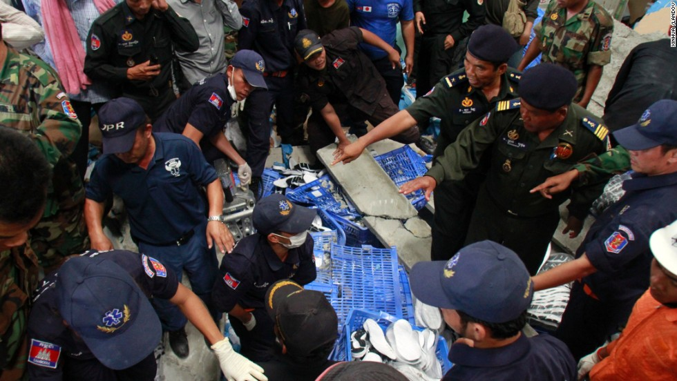 Rescuers search for victims. The cause of the collapse is under investigation, a National Police spokesman said.
