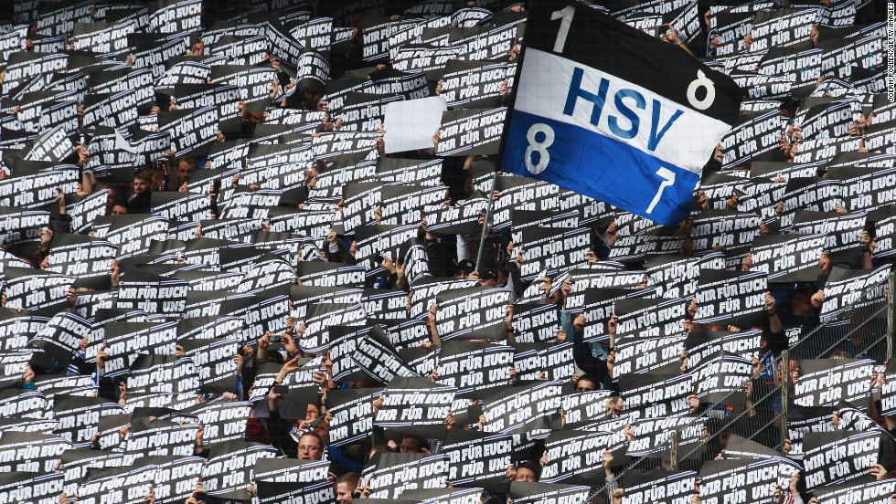 "All but three top-flight clubs -- Bayer Leverkusen, Wolfsburg and Hoffenheim -- are owned by supporters under the 50+1 rule, that dictates clubs must be majority owned by fans to prevent them being taken over by private investors. The last vote on changing the ""50+1"" rule came back in 2009 and only Hannover 96 voted to scrap it. Here Hamburg fans hold up banners at a recent Bundesliga match against Hannover that reads: ""Us for you, you for us."""