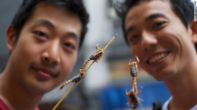 "Although scorpions aren't taxonomically insects, they still made it on to the U.N. report. They're more of a tourist draw than conventional Chinese cuisine, and can be found at street stalls dotting Beijing's major shopping street of Wangfujing. ""They taste like anything deep-fried -- crunchy and oily but no real flavor,"" says Soon Ho Lee, one of the adventurous tourists in this photo."