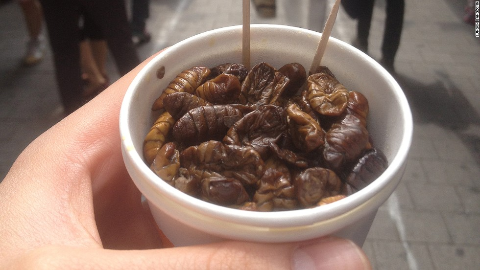"Called beondegi in Korean, boiled silkworm pupae are sold in small paper cups at street stalls in many Korean markets. Korea also uses silkworm powder as medicine for diabetes as it lowers blood glucose levels. This cup cost 2,000 won (about $2) from Seoul's <a href=""http://www.namdaemunmarket.co.kr/"" target=""_blank"">Namdaemun market.</a>"
