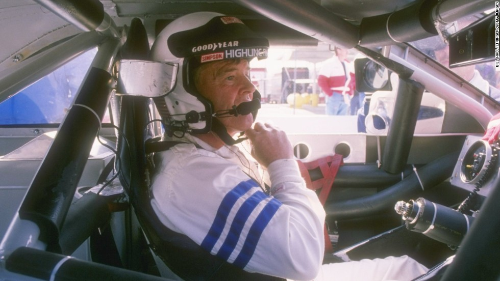 Dick Trickle sits in his car before the start of a NASCAR race in 1993.