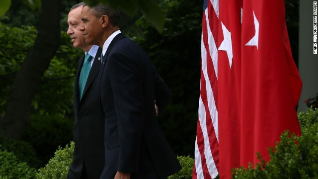 U.S. President Barack Obama and PM Recep Tayyip Erdogan of Turkey walk into the White House Rose Garden, May 16, 2013.