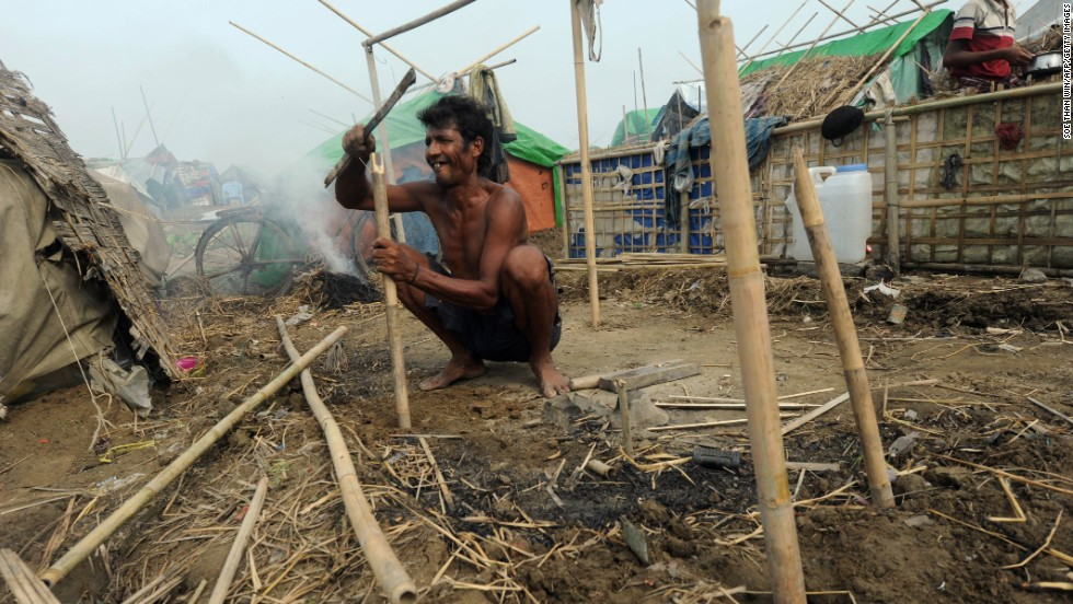A man works on a tent after arriving at a camp for internally displaced people in the village of Mansi, Myanmar, on Friday, May 17. Safety concerns prompted authorities and relief agencies to try to relocate tens of thousands at these makeshift camps as Tropical Cyclone Mahasen neared.