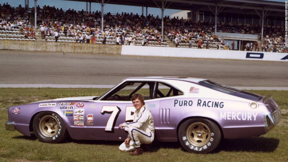 Dick Trickle poses with his Mercury racing car at Daytona International Speedway in February 1975. Trickle died Thursday, May 16, of an apparent self-inflicted gunshot wound, a North Carolina sheriff's office said.