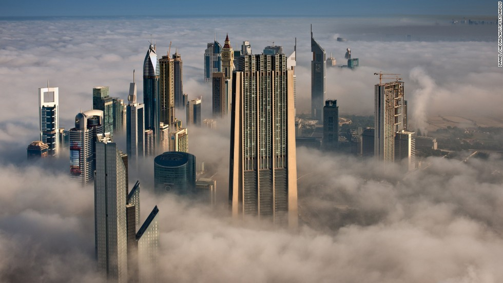 Looking north from the 101st floor of the Burj Khalifa, the Index Tower, center, and other skyscrapers stand high above the clouds.