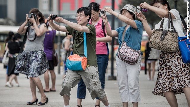 Mainland Chinese tourists break out the cameras to capture a special Hong Kong moment.