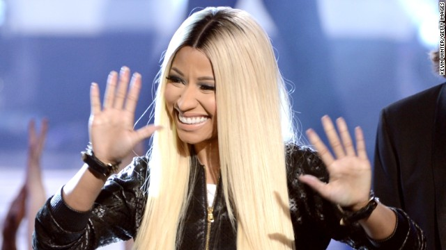 "Nicki Minaj waves to the crowd during the ""American Idol"" 2013 finale on May 16."