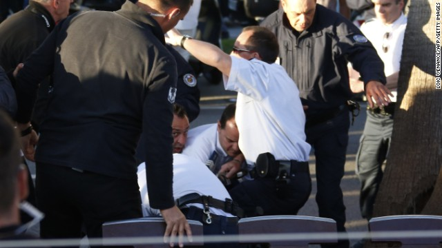 Security members detain an unidentified man on May 17, 2013 following an assault on the set of a show on French tv Canal +, on the sidelines of the 66th edition of the Cannes Film Festival in Cannes. A man was held after using a pellet gun and a dummy grenade in an assault on a TV studio at the Cannes Film Festival, police said. AFP PHOTO / LOIC VENANCE (Photo credit should read LOIC VENANCE/AFP/Getty Images)
