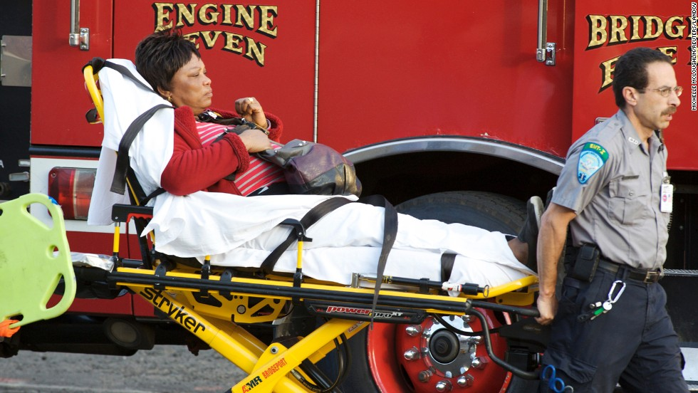 A woman injured in the crash is prepared to be transported to the hospital.