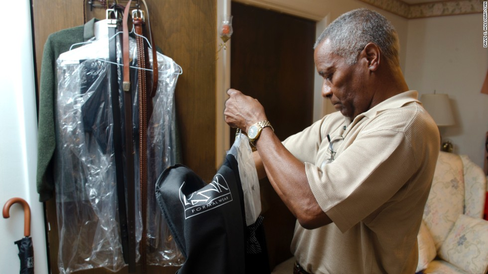 "Eugene Arms, another member of the Class of 1963, gets his suit ready for Friday night's prom. Arms said he attended civil rights rallies in Birmingham as a teenager, but not the pivotal Children's March, when hundreds of children, some as young as 6, left school to march in opposition to segregation. Authorities responded with fire hoses and dogs. ""All we did was give up prom,"" he said."