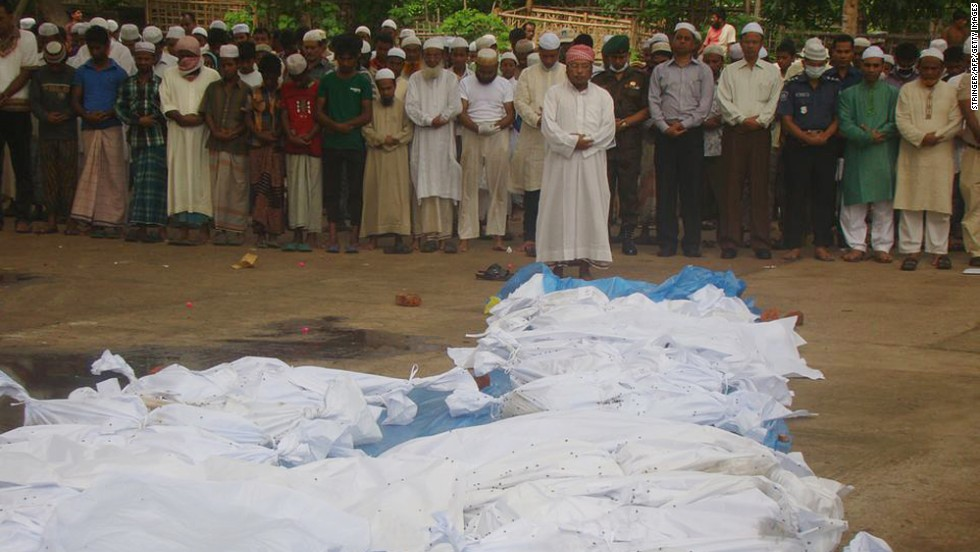"Bangladeshi men pray in front of the bodies of victims of Cyclone Mahasen in Tekna, south of Dhaka, on Friday, May 17. The bodies washed up on the shores of Bangladesh after the victims' boat capsized while sailing from Myanmar. <a href=""http://edition.cnn.com/2013/05/16/world/asia/tropical-cyclone-mahasen/?hpt=hp_t1"">At least 12 deaths have been reported in Bangladesh</a> due to the cyclone."