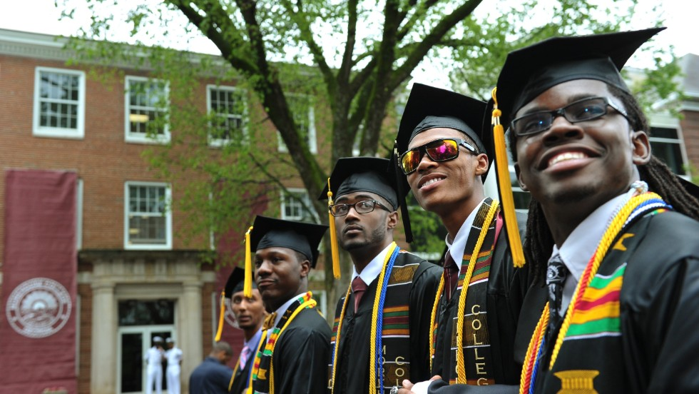 Members of the graduating Class of 2013 stand during the commencement ceremony before Obama speaks.