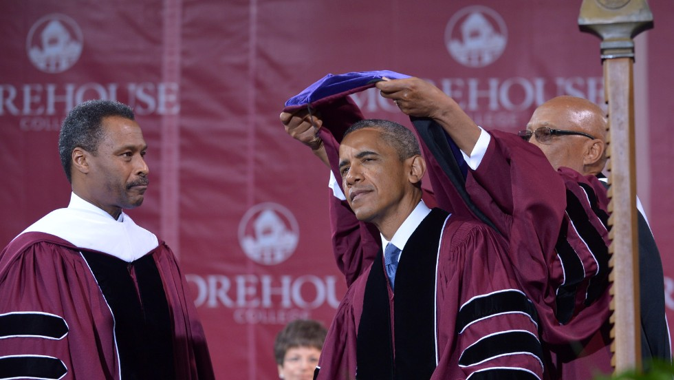 Obama is capped after receiving the honorary doctor of law degree by John Wilson, president of Morehouse College.