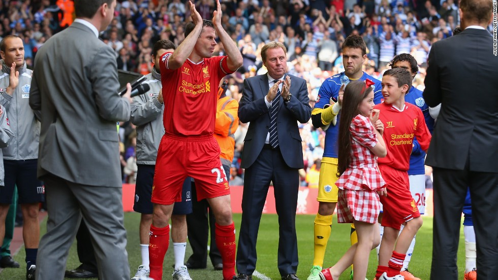Jamie Carragher is applauded on to the pitch for his final game for Liverpool against Queens Park Rangers.