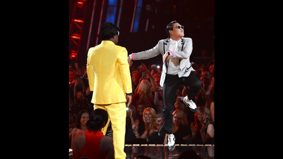 Host Tracy Morgan and musician Psy speak onstage.