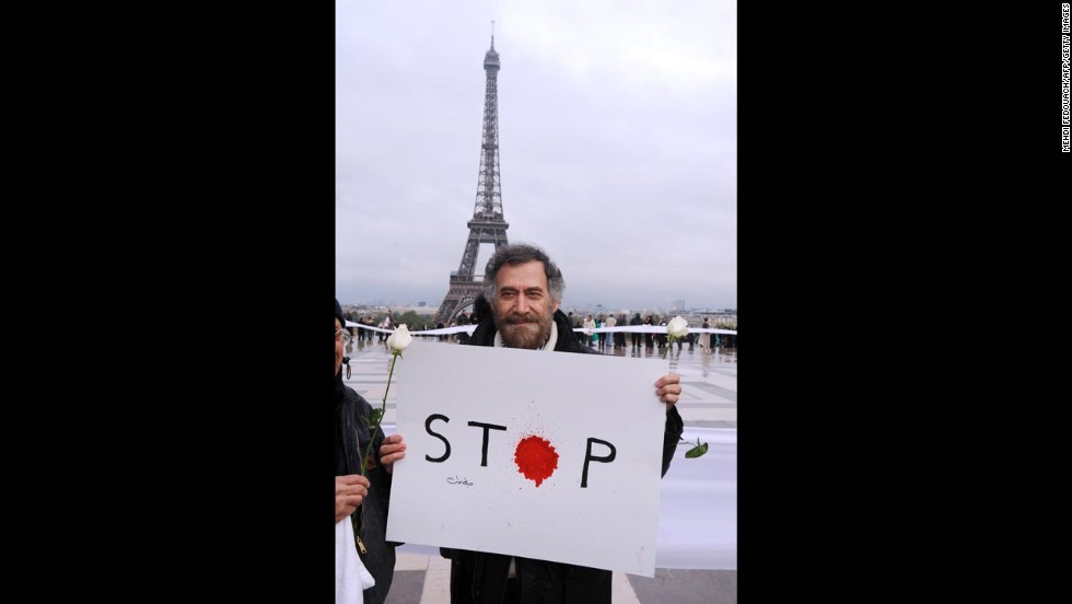 The artist, who now lives outside Syria, protests the violence in April 2012. He remains optimistic about the torn nation's future.