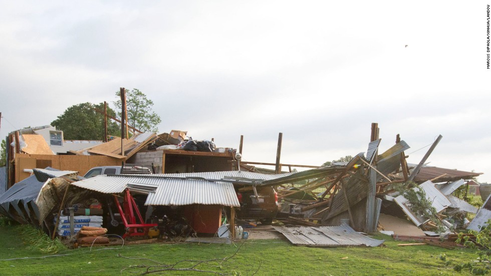 A home in Shawnee sits in ruin after being hit by a tornado on Sunday, May 19.