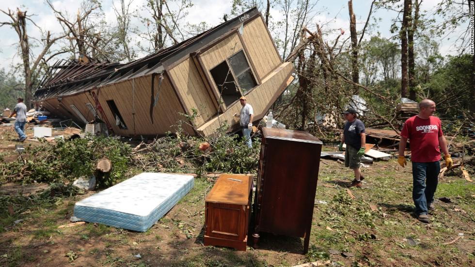 Jean McAdams' mobile home near Shawnee, Oklahoma, lies overturned on May 20.