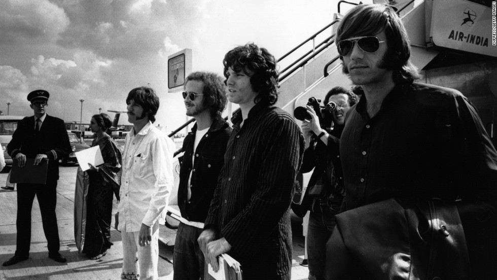 "From left, Densmore, Krieger, Morrison and Manzarek arrive at the London Airport in 1968. Their third studio album, ""Waiting for the Sun,"" was released that year."