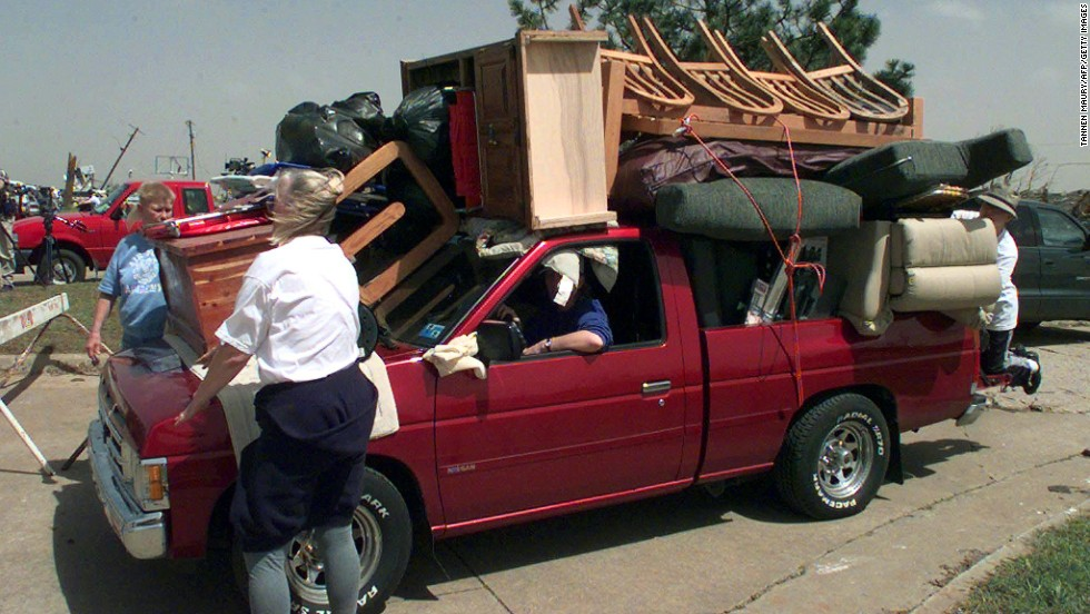 Moore residents remove possessions from their tornado-ravaged homes on May 4, 1999.