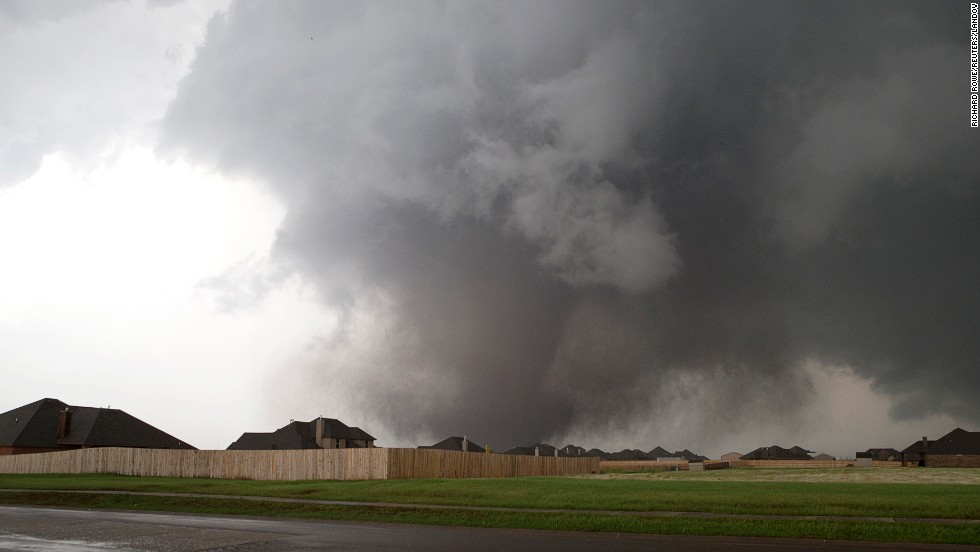 "A massive tornado approaches Moore on May 20. The storm first touched down to the west of the city near Newcastle, Oklahoma. Visit <a href=""http://www.cnn.com/SPECIALS/impact.your.world/"">CNN.com/impact</a> for ways to help the victims."