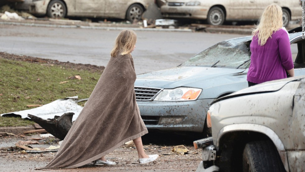 A girl wraps herself in a blanket near the Moore Hospital on May 20.
