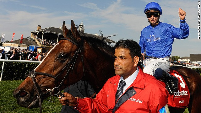Jockey Mickael Barzalona celebrates after leading Encke to a surprise success in last year's prestigious St Leger at Doncaster.