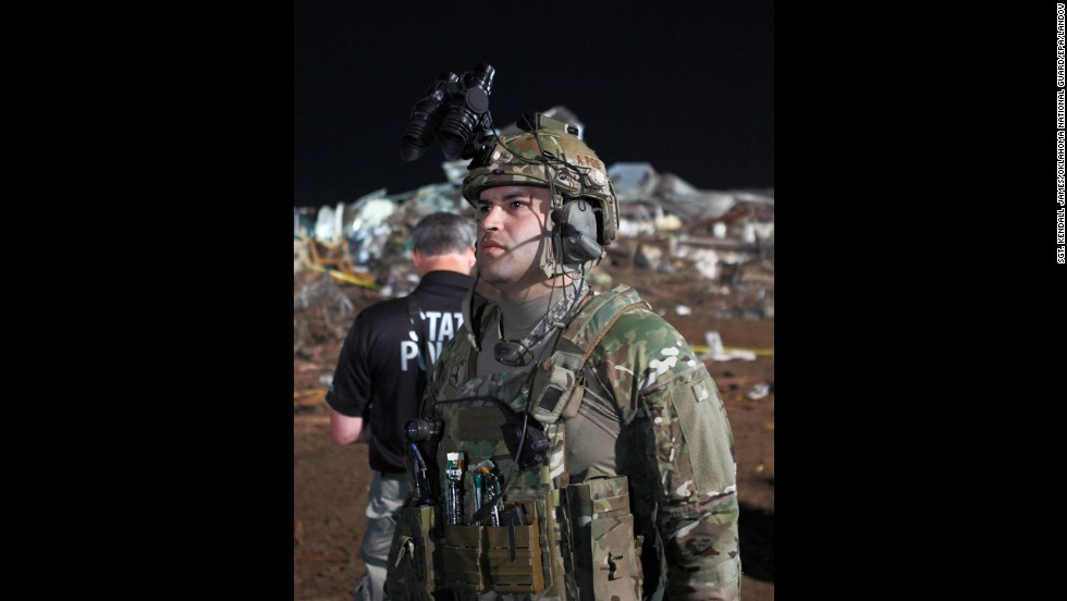 A National Guardsman assists in the search for victims on May 21.