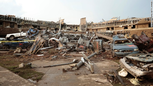 MOORE, OK- MAY 20: Cars marked with an orange 'X', denoting they had been checked for occupants, are piled up in what was the front entrance to the damaged Moore Medical Center after a powerful tornado ripped through the area on May 20, 2013 in Moore, Oklahoma. The tornado, reported to be at least EF4 strength and two miles wide, touched down in the Oklahoma City area on Monday killing at least 51 people. (Photo by Brett Deering/Getty Images)