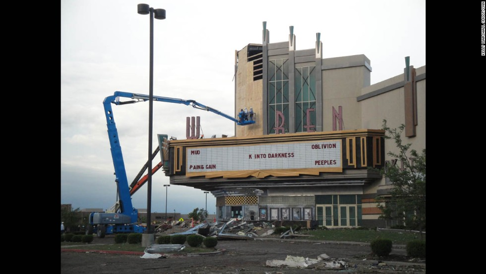Workers clean up the Warren movie theater in Moore on May 21.