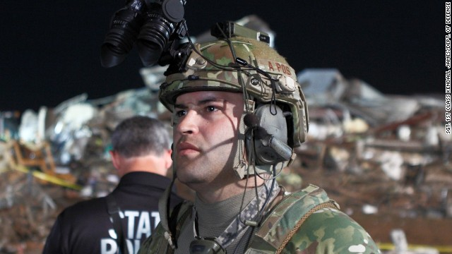 A member of the Oklahoma National Guard uses night vision goggles to help in the search for survivors in Moore, Oklahoma.