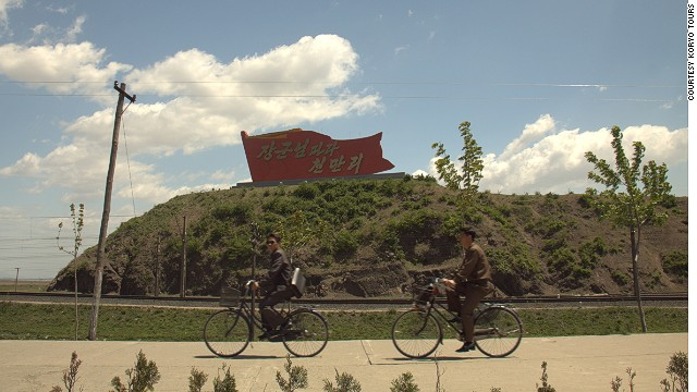 Sinuiju is home to standard DPRK landmarks bearing giant propaganda slogans.