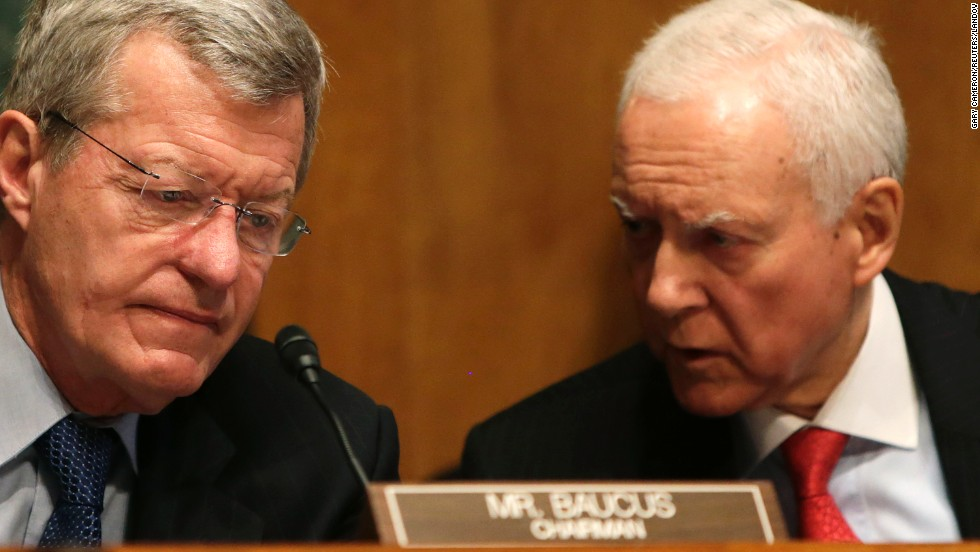 Sens. Max Baucus, left, and Orrin Hatch, co-chairmen of the Senate Finance Committee, confer in Washington in May 2013, during a hearing regarding the targeting of conservative groups.